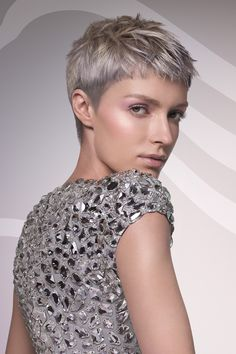 Love the cut, but also love the color.... I am intrigued by the shades of gray showing up! Not sure it would work on me.....