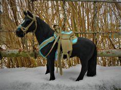 Schleich horse with western tack.