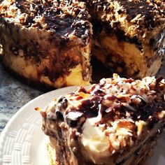 Homemade samoa (inspired) icecream cake.   Ingredients:  1 package of oreos  3 Tbs butter (melted)  1 Jar hot fudge  3 Cups coconut (toasted)  Caramel syrup  1 Gal. Vanilla Ice Cream.  Blend 1/2 the oreos and mix with melted butter to make the first layer crust. Crush the rest of oreos to make a cookie crumble. Layer as you wish with different combinations of fudge, caramel, coconut and oreo crumble between layers of ice cream!   We used a cheese cake pan which worked perfect! TOO GOOD…