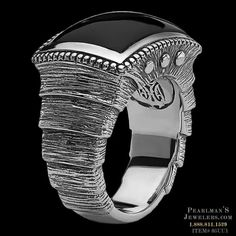 A Scott Kay Men's layered Brushed Armor Samurai Ring. This Scott Kay ring features a black onyx cabochon stone and brushed silver carving, with layered design inspired by ancient samurai armor. The front side of the ring measures 11/16 inch by 15/16 inch; on the back side it's 5/16 inch wide. Sizes range from 8-13 are available by special order.