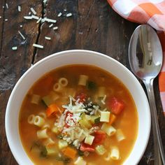 Crock Pot Minestrone Soup Recipe Soups with white beans, reduced sodium chicken broth, olive oil, chopped onion, carrots, diced celery, garlic cloves, diced tomatoes, parmesan cheese, rosemary sprigs, bay leaves, fresh basil, flat leaf parsley, kosher salt, zucchini, spinach, small pasta, parmesan cheese