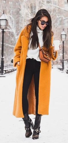 Find a signature item this winter and wear it with pride. It doesn't get any more avant-garde than an ankle-length coat in decadent mustard yellow. #winteroutfits #winterfashion