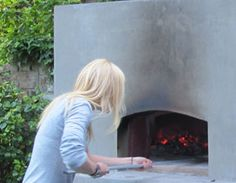I would really like to get a wood burning oven. I think the traditional are beautiful, but this one Gwyneth Paltrow has is amazing.