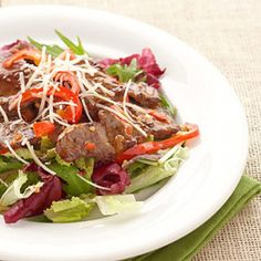 Hot Italian Beef Salad - Quickly stir-fry the steak slices and sweet pepper strips, then toss with bottled salad dressing for a satisfying 20-minute dinner.