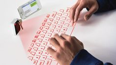 CTX's Virtual Keyboard projects a usable laser outline of a QWERTY keyboard onto any flat ...
