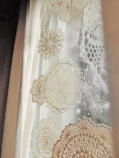 Doily Snowflakes by fieldandsea, via Flickr: Use a handful of vintage / thrifted doilies for the flakes. After giving them a wash, measure half and half epsom salts and water. Bring the water to a boil first, then add the salts, stir until dissolved. Take it off the heat then dip the doilies. Press the liquid out and put to dry on a tea towel. Should be stiff and ready for thread by overnight.
