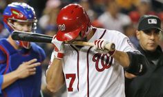 Biting the bat -        Washington Nationals starting pitcher Gio Gonzalez bites his bat in frustration after striking out on a fouled bunt attempt during the third inning of a baseball game against the Chicago Cubs at Nationals Park on June 4 in Washington.  -   © Alex Brandon/AP Photo