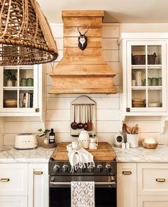 What a beautiful Wednesday it is and what a beautiful kitchen this is! We love how styled her kitchen and how GORGEOUS the hood and stove cover is! We LOVE the mixes of woods and whites! Farmhouse Kitchen Inspiration, Modern Farmhouse Kitchens, Home Kitchens, Farmhouse Sinks, Dream Kitchens, Wooden Range Hood, Kitchen Decor, Kitchen Design, Kitchen Ideas