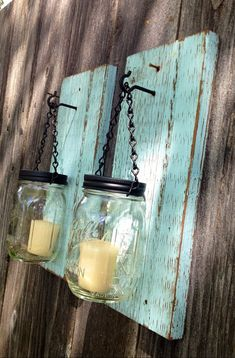 Turquoise barnwood mason jar candle holders.