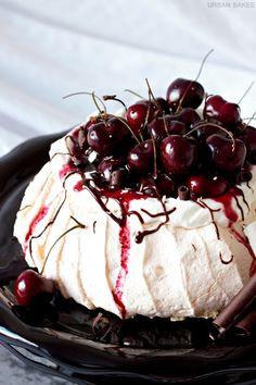 Black Forest Pavlova | URBAN BAKES Tart red cherry compote with drizzled dark chocolate, and white chocolate shavings topped over a lightly sweetened, airy, merengue-like cake is the perfect summer treat.