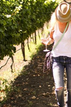 I enjoy walking thru the vineyards checking on the vines and sipping a bit if vino from the barrels.......