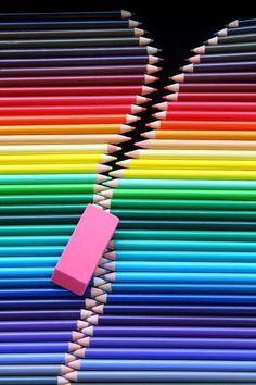 Rubber & coloured pencils zip, or if you're American: Eraser & colored pencils zipper! :-s