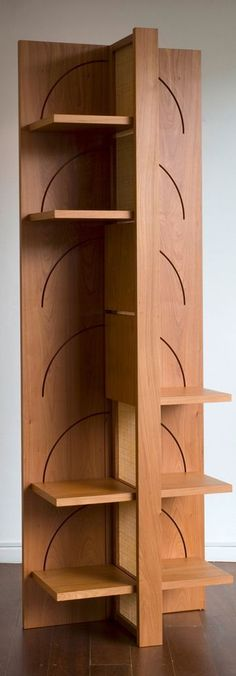 """Bedouin is an elegantly designed bookshelf that can be transformed into a compact, easy-to-transport piece of luggage. It is operated by interactive movements: like a book that is opened, the shelves unfold to become a bookshelf. It is supported by a hollow centre axis, which also serves for ventilation. Etel Marcenaria"""