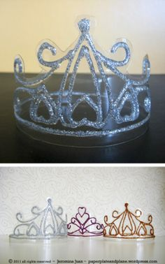 Crowns made from soda bottles and glitter glue.  Love love love!