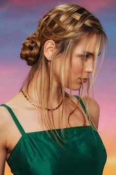Simply Gorgeous Medieval Hairstyle With tendrils hanging out