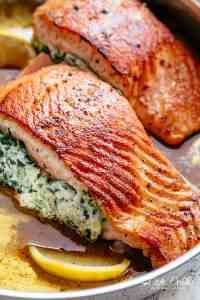Creamy Spinach Stuffed Salmon in garlic butter is a new delicious way to enjoy salmon! Filled with cream cheese, spinach, parmesan cheese and garlic, this salmon beats than anything found in a restaurant. Your new favourite salmon recipe includes pan frie Salmon Dishes, Fish Dishes, Seafood Dishes, Fish Recipes, Seafood Recipes, Cooking Recipes, Healthy Recipes, Healthy Ramadan Recipes, Cajun Shrimp Recipes