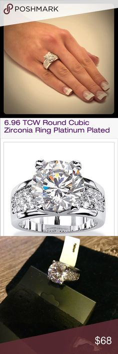 6.96 TCW Round Cubic Zirconia ABSOLUTELY STUNNING!!!! 6.96 TCW Cubic Zirconia Ring. Sterling Silver/platinum plated. The main stone will catch ANYONE's eye! Jewelry Rings