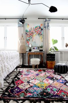 Such a beautiful boho artsy bedroom! That Boucherouite rug from Baba Souk