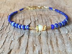 A personal favourite from my Etsy shop https://www.etsy.com/no-en/listing/555562790/blue-gemstone-lapis-lazuli-and-opal-24k
