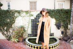 camel vest + black dress