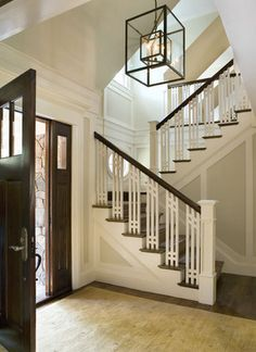 Craftsman styled stairway Love the switchback staircase and the window in the landing. Light, bright, AND warm.