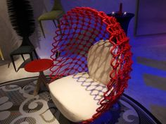 DRAGNET CHAIR. In vibrant red, the Dragnet Chair is made of polycotton and stainless steel | Kenneth Cobonpue