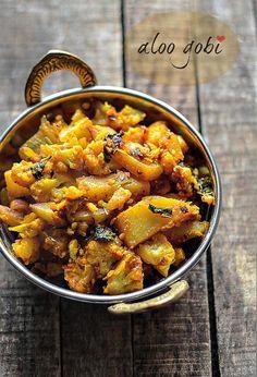 Aloo Gobi Recipe: Punjabi-style aloo gobi recipe, a classic dry vegetable dish w. - Aloo Gobi Recipe: Punjabi-style aloo gobi recipe, a classic dry vegetable dish with aloo (potatoes) - Gobi Recipes, Curry Recipes, Potato Recipes, Indian Food Recipes, Ethnic Recipes, Punjabi Recipes, Aloo Gobi Recipe Dry, Aloo Gobi Recipe Punjabi, Vegan