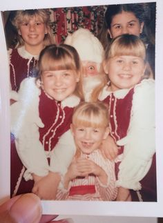 Went through boxes of pics from our move to CA...found this one of my sisters and I with Santa (or part of Santa)!