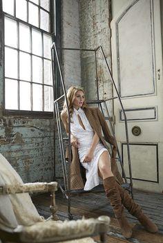 Wearing an Altuzarra dress and jacket and Manolo Blahnik boots. Image Source: Courtesy of Holt Renfrew/Holt...