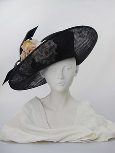 Wide-brimmed hat with silk flowers (front view) | Label: Philip Treacy | Black sinamay 'large upturn' hat with buntal hat band and twirls and pale pink silk flowers.  Secured by two wired grips. Summer wear | Made in England