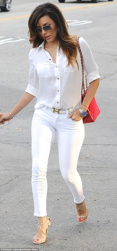 Eva Longoria in a silk white shirt, an Hermes belt, white jeans, Jimmy Choo Lance Sandals in Nude and Ray-Ban 3025 sunglasses.                                                                                                                                                     More