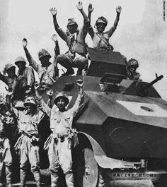 Japanese Soldiers posing with a Captured Dutch Overvalwagen armored car, Dutch East Indies 1942.