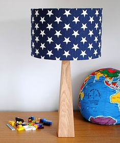 I've just found Handmade Blue Stars Table Lamp. This lovely handmade table lamp is stylish for any room. Star Light Shade, Blue Lamp Shade, Light Bulb, Wooden Table Lamps, Oak Table, Bar Set Furniture, Funky Cushions, Childrens Lamps, Star Cushion