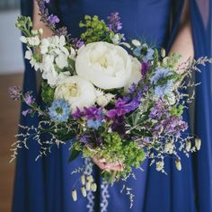 A local sourced wedding is full of natural elements & wild flowers. With a bespoke blue wedding dress & the famous River Cottage as a venue