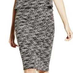 Vince Camuto Graphic Flutter Midi Tube Skirt The slimming, stretchy silhouette of the Graphic Flutter Midi Tube Skirt looks cool with its trendy speckled design. An office-friendly cut with a playful print and linear back zipper works well for the transition from work to cocktails. 93% Polyester, 7% Spandex Vince Camuto Skirts Midi