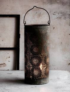 Beautiful old punched tin to cover a candle and allow it to glow through the holes Wedding Lanterns, Candle Lanterns, Lanterns Decor, Primitive Lighting, Primitive Candles, Rustic Lighting, Yoga Studio Design, Deco Nature, Houses