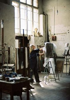 Love this art studio.  I dream of painting in a high-ceilinged big-windowed space like this.  Oh swoon!