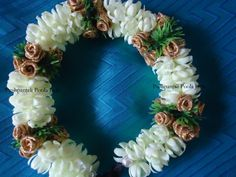 veni or gajra made with artificial jasmine buds and artificial gold roses
