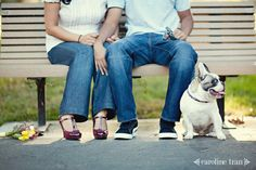 Sitting on bench, just legs with dog