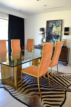Peach & gold dining chairs, brass and glass dining table, zebra rug, abstract art and burl wood console - lovely dining room via Thompkins Lloyd Interior Designs Dining Chair Cushions, Dining Chairs, Dining Rooms, Glass Dining Table, Dining Room Inspiration, Dining Room Lighting, Dining Room Design, Interiores Design, Decoration