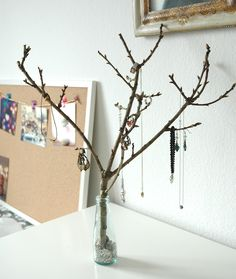 DIY Jewelry Tree  Could spray paint the branches to add extra glam