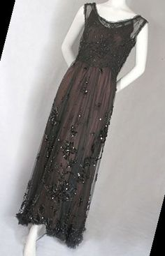 From the seller: The dress is fashioned from black silk tulle. The bodice is lined with black silk chiffon: the skirt is unlined. It closes in back with hooks and snaps. The silhouette of this gown typifies high style elegance, with the bodice is slightly high waisted in front, gracefully dipping lower in back. This contour line is repeated in the dipping skirt hem that forms a train in back. The dress is embellished with floral clusters of black Cute Teen Dresses 45+ Lady Mary Eat You Cute Dresses For Teens, Teen Dresses, Prom Dresses, Formal Dresses, Fall Family Photo Outfits, Lady Mary, Eyeshadow Looks, Silk Chiffon, Black Silk