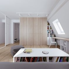 By creating a long desk area underneath the slanted attic windows, the designers also deliberately make more storage space.