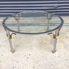 (Shipping is extra- If you would like a freight shipping quote, please contact me before buying. Thanks!) Vintage round chrome and brass coffee table with glass top. Simple, modern brass fretwork pieces on the corners. In good vintage condition, some patina and aging to the brass, light wear to the chrome, some light scratches to the glass top. Measures approximately 36 wide x 16 tall. PLEASE NOTE: This item will be shipped by freight. Buyer will be responsible for shipping fees. Please…