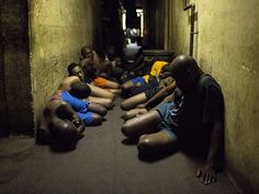 People living in a hostel wait in a hallway during a joint South African Police and South African army raid in Johannesburg.South African soldiers are attempting to stop gangs who are hunting down and killing foreigners.  Marco Longari, AFP/Getty Images