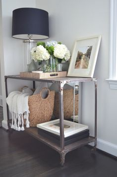 A $79 potting table from Home Depot makes a beautiful entry console with a silver spray from rustoleum .