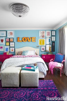 L wants her room to be *exactly* like this. Blue walls, cool rug, but with day bed, same pillows and blankets, artwork, fancy chair, LOVE marquis lights, crystal light fixture.