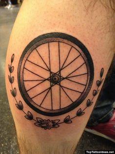 Bike wheel tattoo