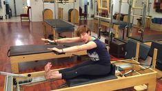 Lesley Logan, author of Profitable Pilates, teaches the Pilates exercise 'Overhead with the Magic Circle' on the Reformer at Westwood Pilates studio in Los A. Pilates Classes, Pilates Studio, Pilates Reformer, Pilates Workout, Equinox Fitness, Pilates Equipment, Joseph Pilates, Masters Programs, How To Grow Taller