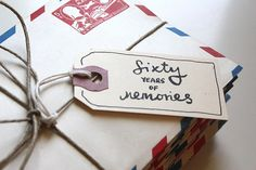 "For her dad's 60th birthday, Holly collected a favourite memory of her dad from 60 people, put each in a separate vintage envelope, and gave him the gift of ""60 Years of Memories""."